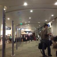 Photo taken at Gate 22 by Jon S. on 2/3/2014
