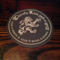 Photo taken at Thirsty Lion Pub & Grill by Mike N. on 7/13/2013