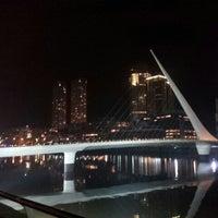 Photo taken at Puente de la Mujer by Santiago M. on 7/13/2013