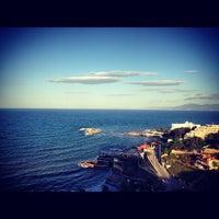Photo taken at Kuşadası Sahili by Pelin's 🎀 on 5/10/2013