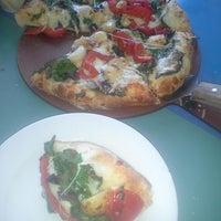 Photo taken at Reginelli's Pizzeria by Jessica C. on 8/3/2013