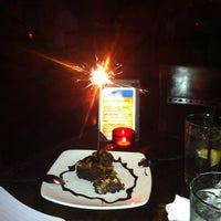 Photo taken at Babaloo International Cafe and Bar by Mara F. on 7/14/2012