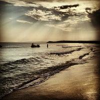 Photo taken at Ramo Beach by Caglar A. on 8/17/2013