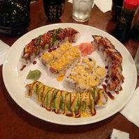 Photo taken at Momo Sushi & Cafe by Sean A. on 1/6/2013