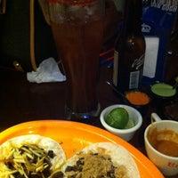 Photo taken at El Taco Con Botas by Karla G. on 11/15/2014