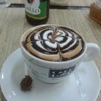 Photo taken at Café Petit by Graziela S. on 6/28/2013