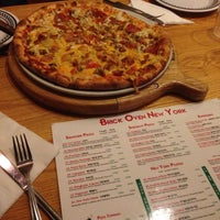 Photo taken at Brick Oven New York Pizzeria by Matthew L. on 7/2/2013