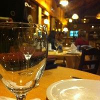Photo taken at Restaurant La Rueda 1975 by Mayara S. on 7/28/2013