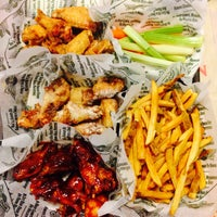 Photo taken at Wingstop by Doyce L. on 6/21/2014