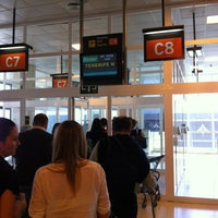Photo taken at Gate C 8 by Julio P. on 3/6/2012