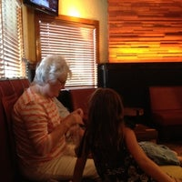 Photo taken at Outback Steakhouse by Mandi K. on 7/22/2012
