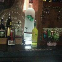 Photo taken at Mulligan's Irish Pub by Sabra C. on 8/23/2011