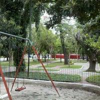 Photo taken at Praça Borges de Medeiros by Andre F. on 2/25/2012