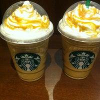 Photo taken at Starbucks by Julia N. on 7/13/2013