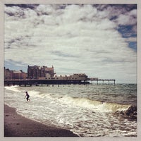 Photo taken at Aberystwyth Beach by Slynky C. on 8/11/2013