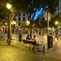 Photo taken at Plaza de Lavapiés by Juan B. on 7/27/2013