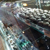 Photo taken at Rocky Mountain Chocolate Factory by Moses W. on 1/2/2013
