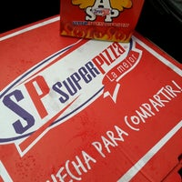 Photo taken at Super Pizza by Janet G. on 9/14/2013