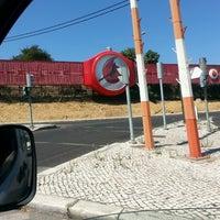 Photo taken at Rotunda do Relógio by Miguel O. on 8/20/2013