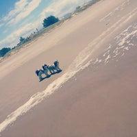 Photo taken at Praia do Barco by Bianca M. on 2/16/2014