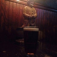 Photo taken at The Green Onion Pub by Katie R. on 10/12/2015