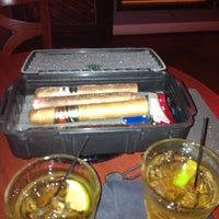 Photo taken at LIT Premium Cigar Lounge by Dennis P. on 10/26/2012