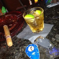 Photo taken at LIT Premium Cigar Lounge by Dennis P. on 7/4/2013