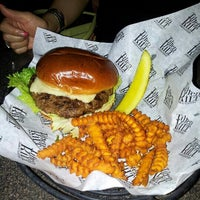 Photo taken at Tilted Kilt Pub & Eatery by Lillian W. on 7/18/2013