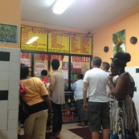 Photo taken at Ali's T & T Roti by John H. on 6/1/2013