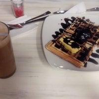 Photo taken at Book Latte by Adohr E. on 2/20/2014