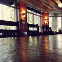 Photo taken at Zoka Coffee Roaster & Tea Company by Kate K. on 4/1/2013