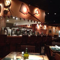 Photo taken at Carrabba's Italian Grill by Christopher V. on 12/2/2013