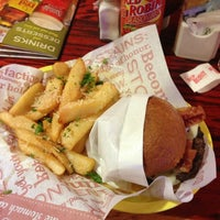 Photo taken at Red Robin Gourmet Burgers by Chris C. on 1/18/2013