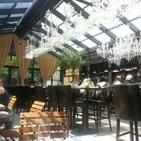 Photo taken at Isola Trattoria & Crudo Bar by Jeannie K. on 6/9/2013