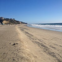 Photo taken at Zuma Beach by Melissa S. on 12/26/2012