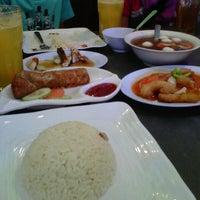 Photo taken at Singapore Chicken Rice SCR by Shamina S. on 1/6/2013
