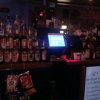Photo taken at Mulligan's Pub by Christy F. on 2/24/2013