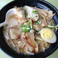 Photo taken at Ajisen Ramen by Troy H. on 1/27/2013