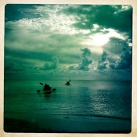 Photo taken at Sapodilla Beach by Tracey H. on 10/22/2012