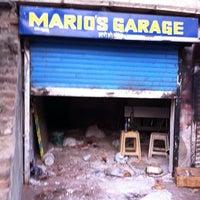 Photo taken at Mario's bike garage by Manoj N. on 2/5/2014