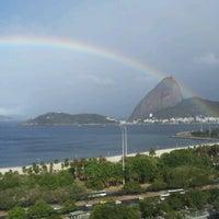 Photo taken at Praia do Flamengo by Kelly F. on 8/30/2012