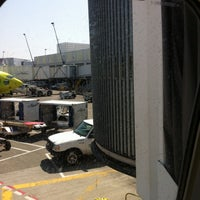 Photo taken at Gate C11 by Dawn S. on 7/10/2012