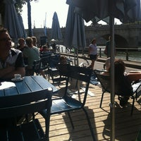 Photo taken at Paris Plages -  Bassin de la Villette by Lola Z. on 8/16/2012