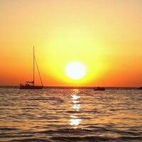 Photo taken at Kini Beach by Lena X. on 3/19/2012
