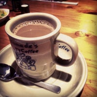 Photo taken at Komeda's Coffee by taku u. on 2/1/2013