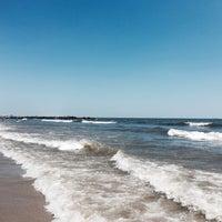 Photo taken at Rockaway Beach by Olya K. on 8/14/2016