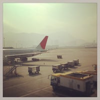 Photo taken at Gate 21 by BJ Y. S. on 12/24/2012