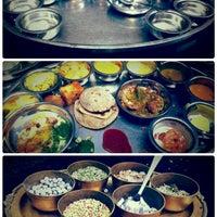 Photo taken at Rajdhani by Meira D. on 1/9/2014