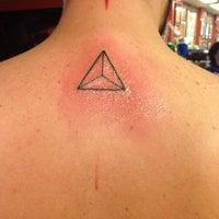 Photo taken at Rising Dragon Tattoos by Felipe G. on 7/7/2015