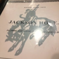 Photo taken at Jackson Hole (Madison Ave) by Diane G. on 12/14/2012